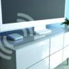 Billede af Loop Pro placeret ved siden af TV